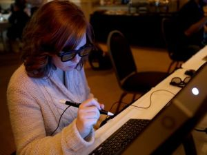 Statesman Journal education reporter Natalie Pate uses a desktop version of virtual reality technology during a presentation for Oregon educators about the possibilities of virtual reality technology in classrooms at the Grand Hotel in Salem on Monday, Nov. 9, 2015. (Photo: ANNA REED / Statesman Journal)