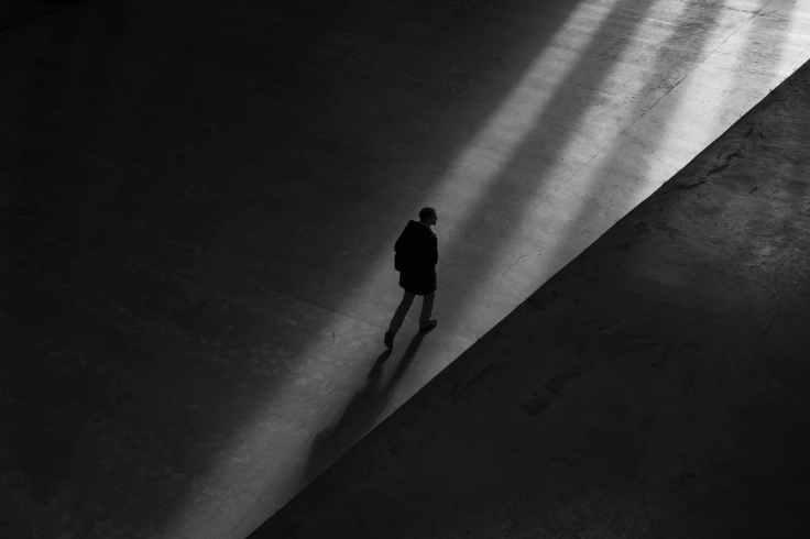 man walking on floor